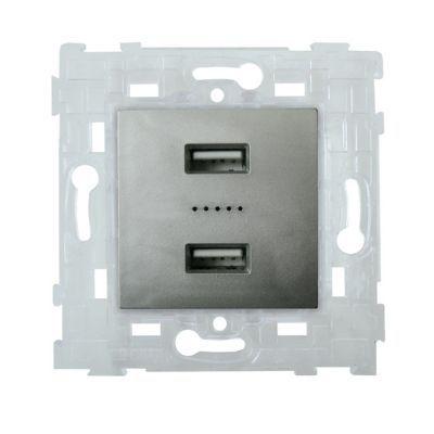 Mécanisme double prise USB métal Kalya. Caractéristiques techniques de ce mécanisme USB : - Série : Kalya. Coloris : Métal. 2 pôles P+T. Conseil d'utilisation : Mécanisme à associer aux plaques de finition Kalya. Restrictions d'usage : Couper le courant a